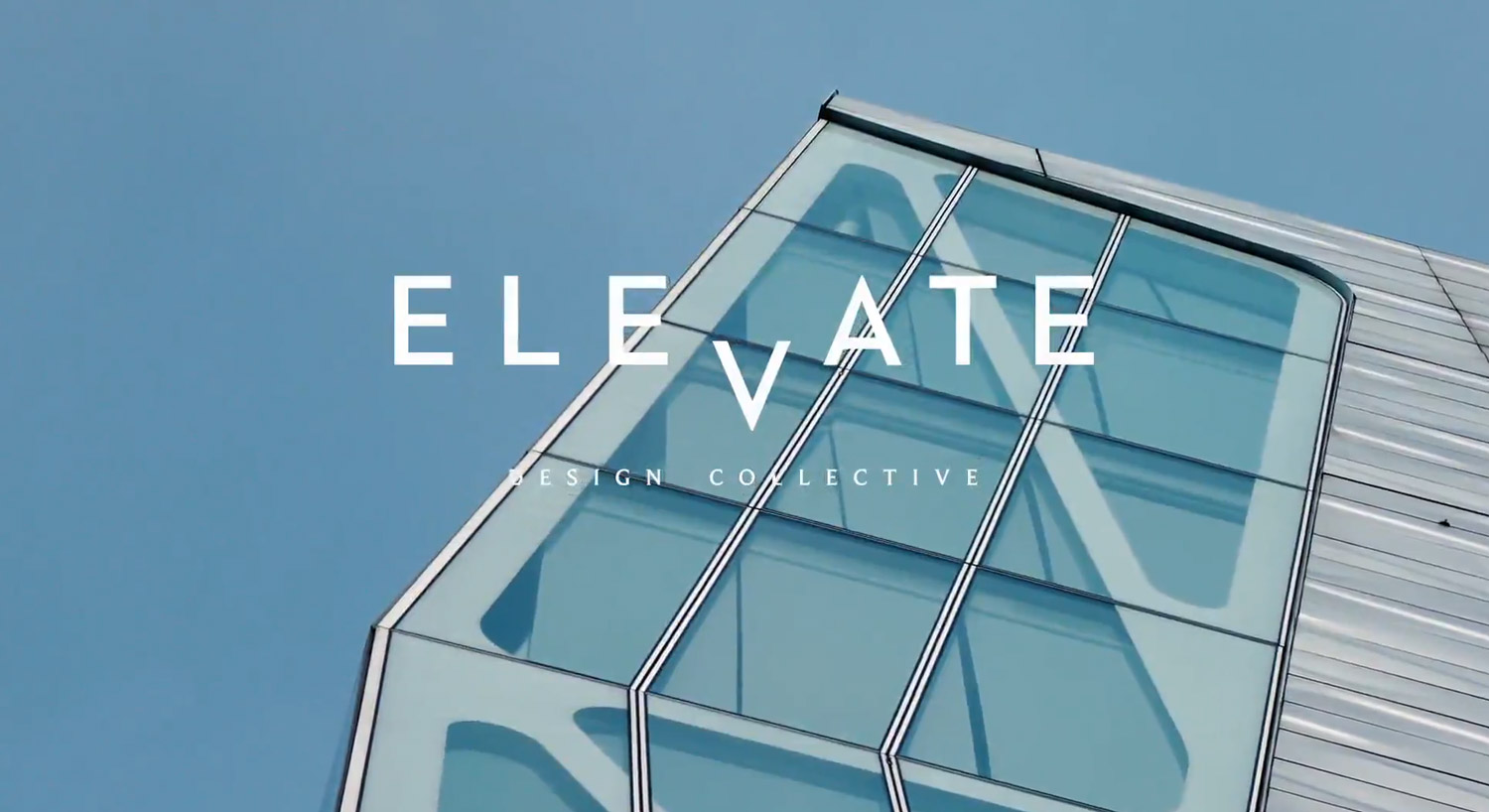 Elevate Design logo over building.